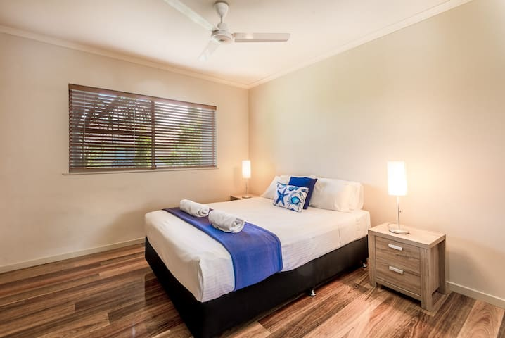 The second bedroom is fitted with a comfortable queen-sized bed and topped with hotel quality linens for a good night's sleep.