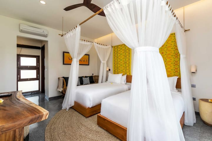 one of the four twin bedrooms