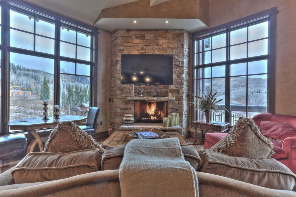 """Living Room with 65"""" HD Smart TV, and Fireplace"""