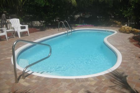 THREE LOTS WITH POOL AND DOCK!! SECLUDED RETREAT