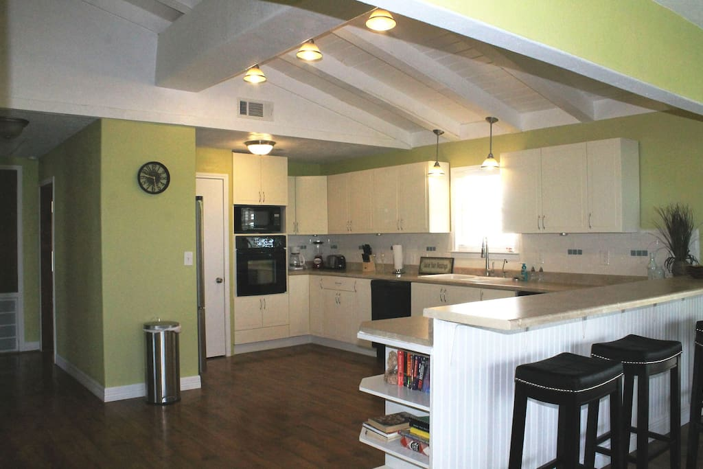 Large updated and open kitchen with recent appliances.  All dishes, utensils, pots and pans included!