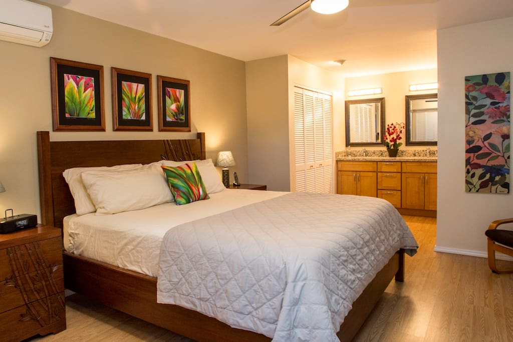 Your master bedroom with California king-size bed, personal safe and flat-screen TV