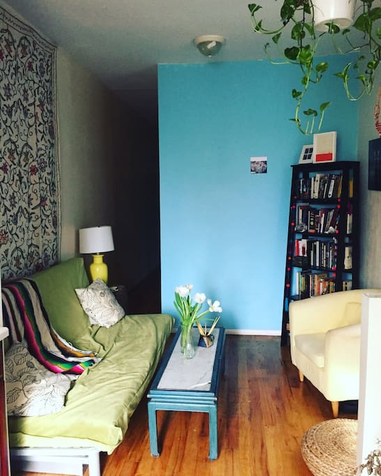 The Livingroom, a comfy common area to get to know your two roommates Xenia and Brittany.