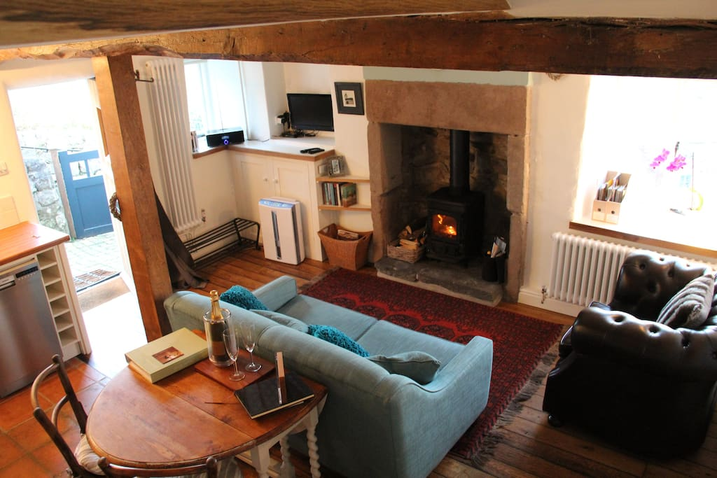 living room with log burning stove  - when extended table can seat dining for 4