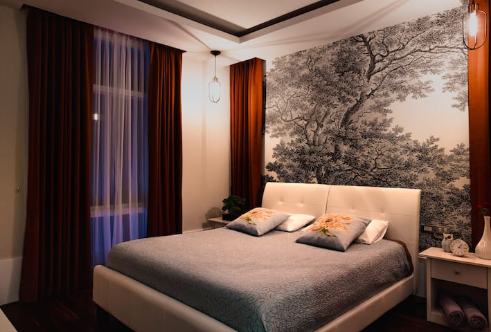 2nd Floor. Bedroom 6. This room has kingsize bedroom, aircond, TV, night tables, view from window to Swimming pool. Night time