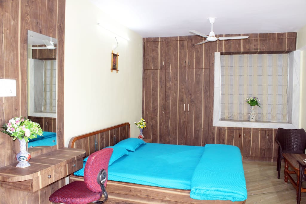 AC Room with Att Washroom, King Size Bed with Mattress Protector, Bedsheet, Pillows and Comforter alongwith Wardrobes, Dressing cum Study Table, Chairs, Centre and Side Table.