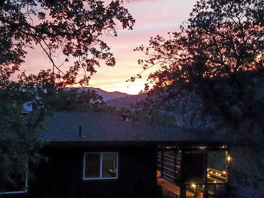 See beautiful Sunsets every night, from this over 1,800 Sq ft. home, that has a large deck, and over an acre of land to explore.