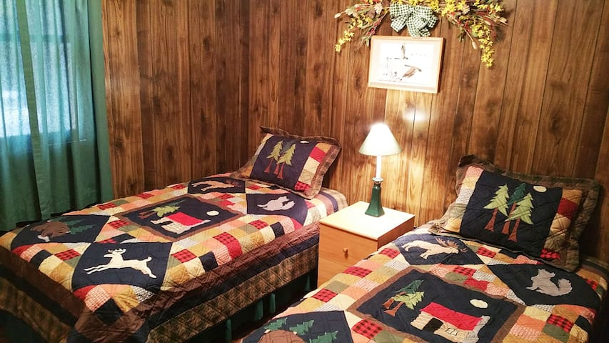Bedroom# 2 updated w/brand new outdoor-themed handmade quilts, shams. Twins fitted w/300 ct 100% cotton percale sheets.  NOTE: For health/safety, pillows/cases no longer provided.