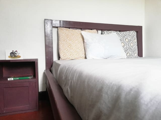 A double bed in a private room