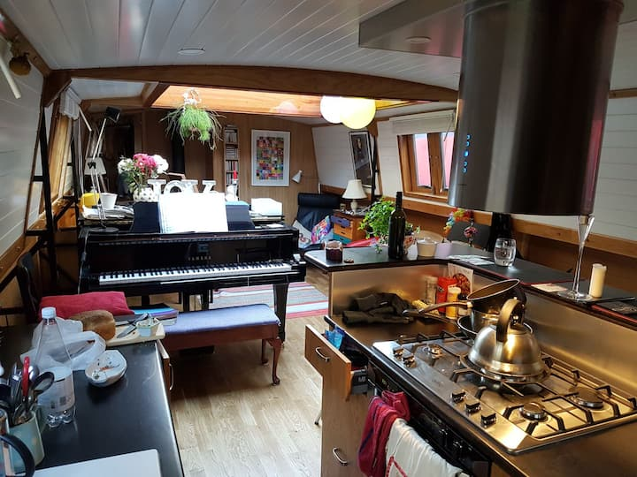 Captain's Cabin in a canal boat with grand piano