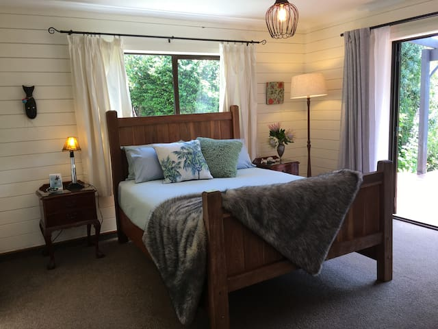 A large bedroom with double doors out to the deck.