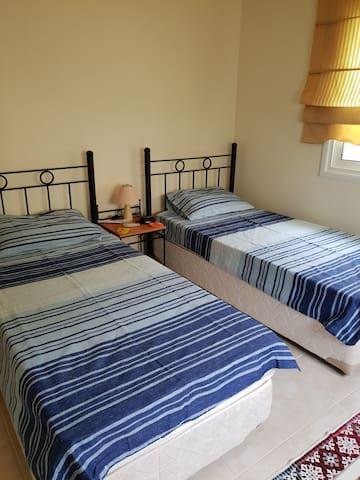 Bedroom 3. 2 single beds, wardrobes  bathroom with shower