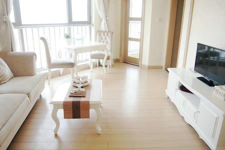 崂山区石老人休闲度假房,独立卧室客厅,让你尽享私人空间,可做饭 - Qingdao - Leilighet