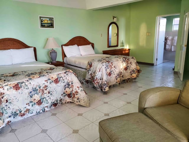 Green Gardenia Room with two Double beds/ensuite bathroom and walkout to pool deck