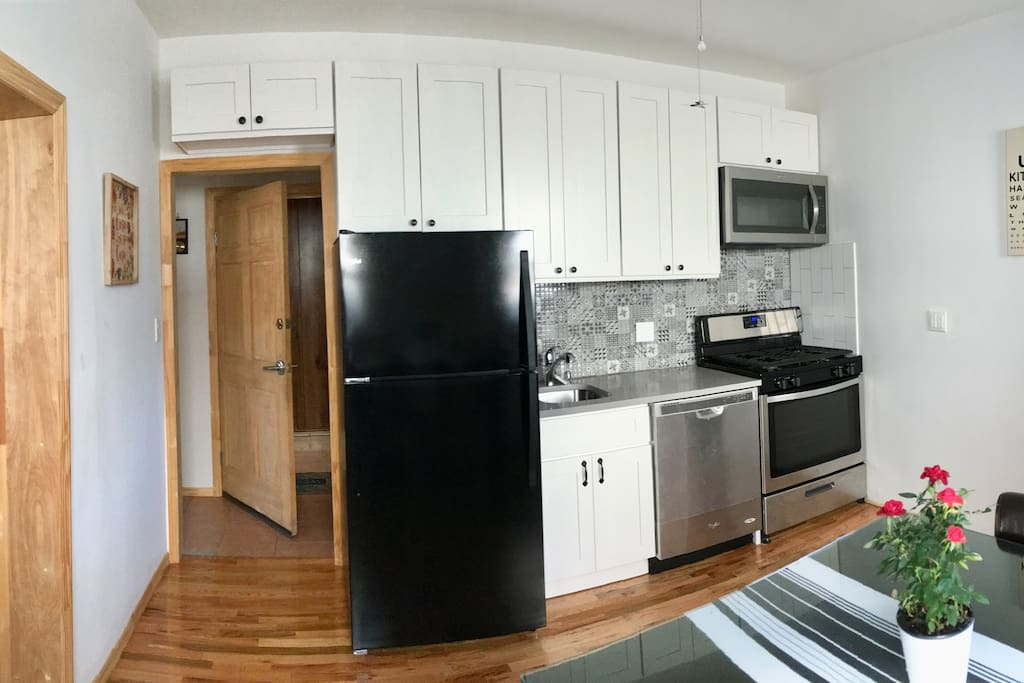 Renovated full kitchen includes microwave and dishwasher