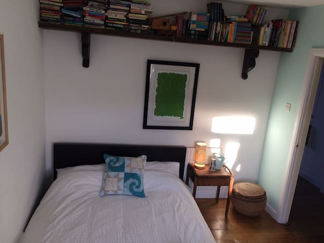 Comfy double bed. House full of books and light