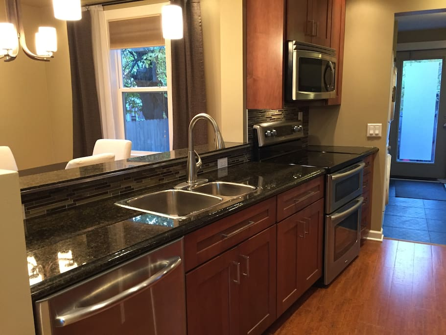 Updated kitchen with stainless appliances and granite counter tops.