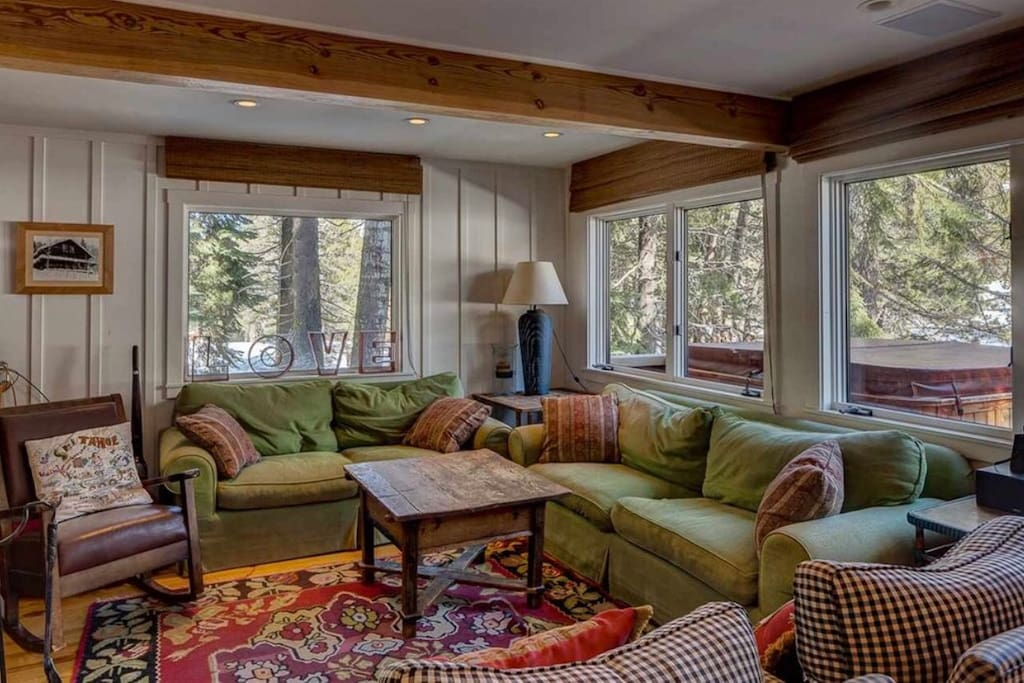 Living room w spectacular view of mountain. Hot tub on deck. Apres' ski?