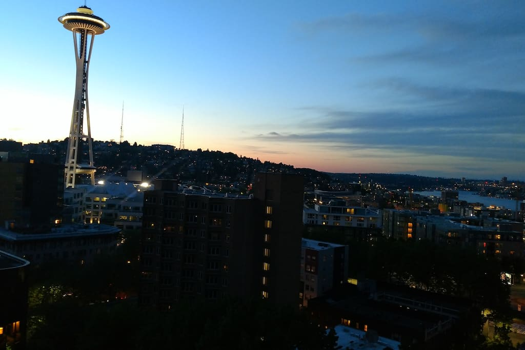 Living room view of Space Needle at sunset