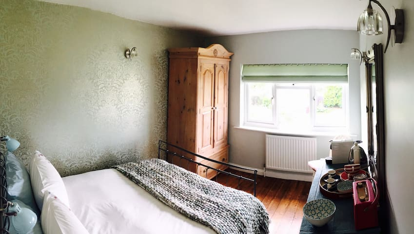 Double bed, hanging space and supplies