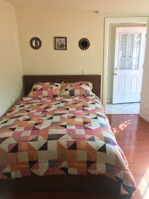 Queen Bed which accommodates up to 2 guests