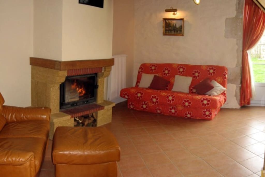 Lounge with enclosed wood burner
