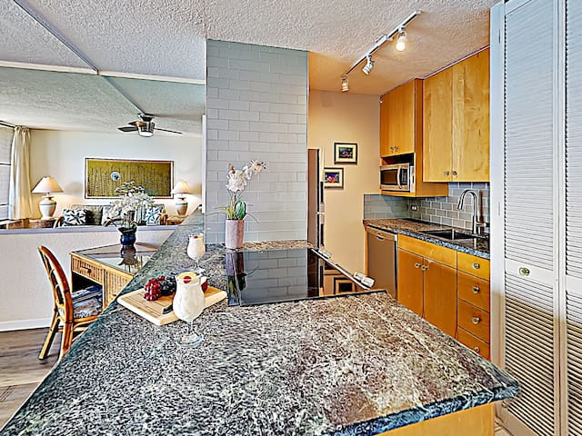 Enjoy serving your guests at the kitchen countertop with bar seating for two.