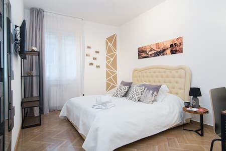 Large Double room,  industrial & vintage style, decorated with  old images of the city. The atmosphere created want to let you enter in a full immersion of Trieste and its history.