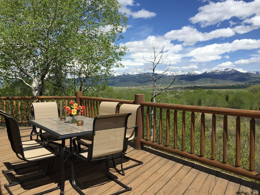 Wonderful outdoor deck area  is perfect for dining, enjoying the mountain views, wildlife viewing, watching beaver in beaver pond  below.