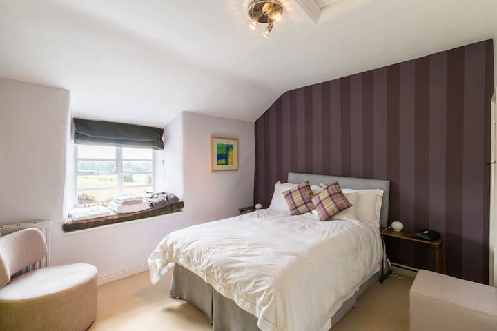 Bens room..standard double bed and funky purple stripy paper..great views..