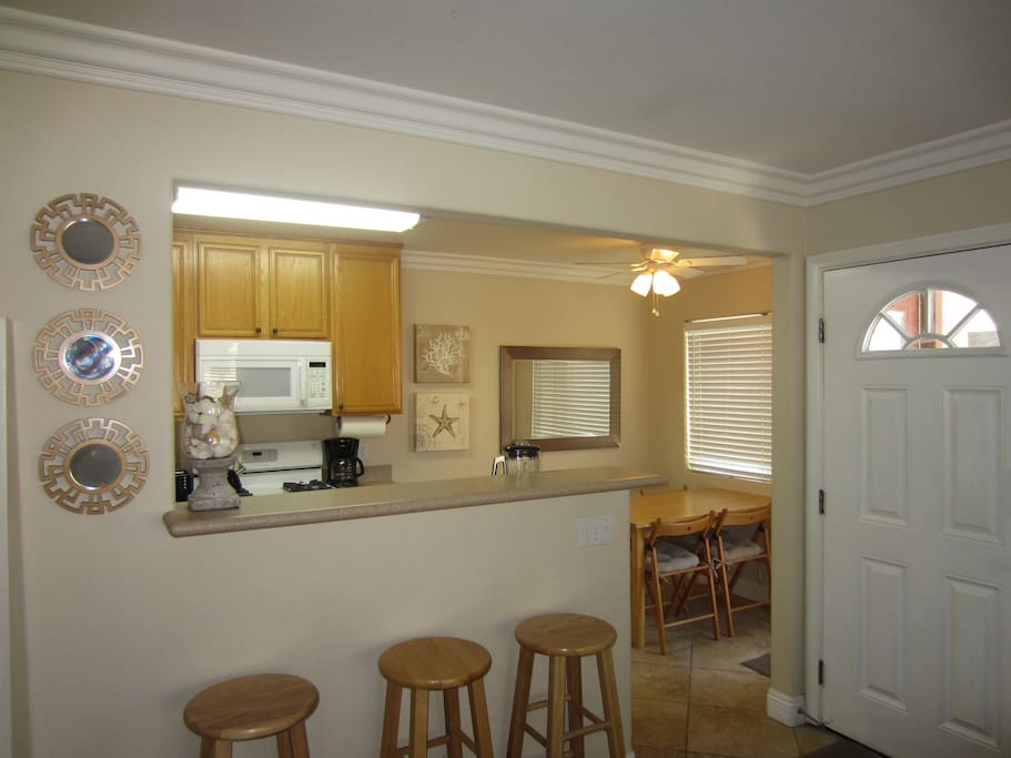 Kitchen with dining area that seat 4 and bar that sets 3.