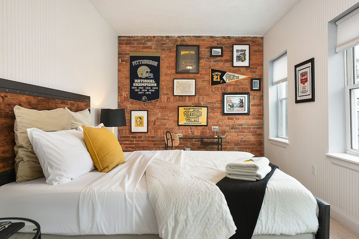 Your Pittsburgh Home Away From Home! This room is an ode to all things 'Burgh. If you're a sports lover, history buff, or a first-timer & want to get familiar with Pittsburgh - this room's got yinz covered!