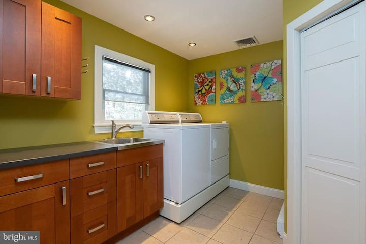 Laundry room area with Speed Queen washer and Dryer.
