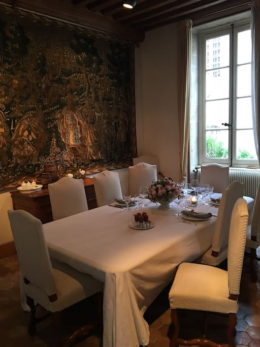 The dining table, adjacent to the kitchen; your room includes a continental breakfast of coffee or tea, croissant or baguette and orange juice.