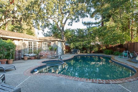 """Big room, closet, desk & 42"""" TV.  Piped-in music W/controls. Private bathroom. Enjoy the pool & hot-tub. Relax in a Zen-like garden with a fountain, reading bench and floral activity. Gated yard protected by the Atherton PD. Desktop computer & WiFi."""