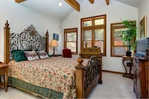Retreat to the master bedroom with exquisite queen bed.