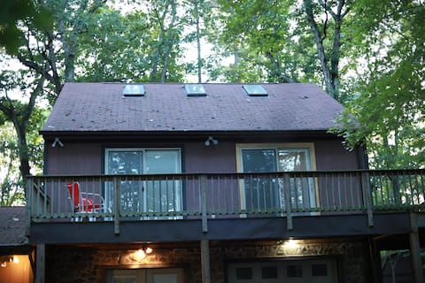 The room upstairs is large and full of light. The deck puts you up in the trees for that outdoors experience.