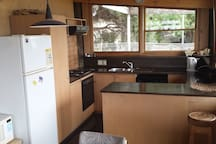 The kitchen is fully self contained with oven, microwave, dishwasher and all cooking equipment