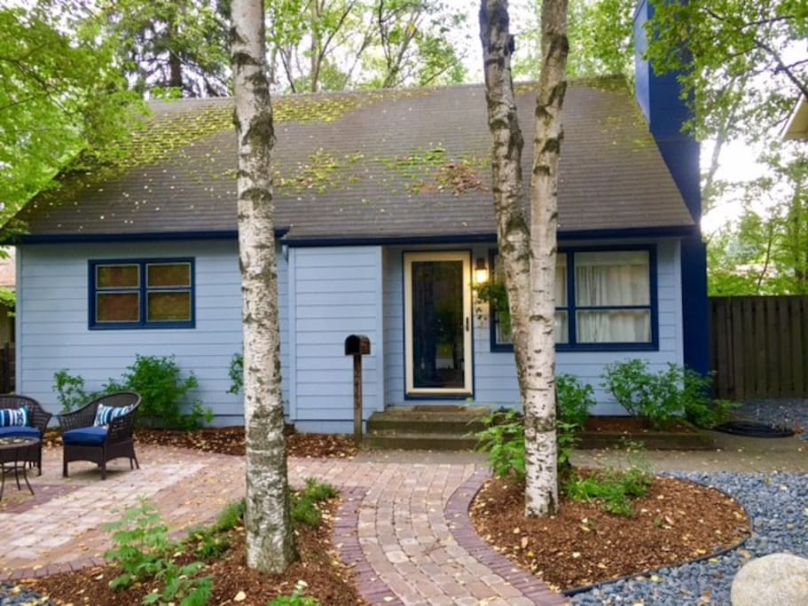 Quiet set back treed property with fenced back yard