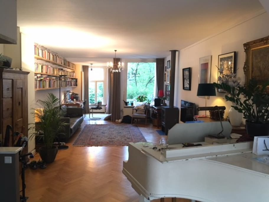 living with little grand piano & view garden