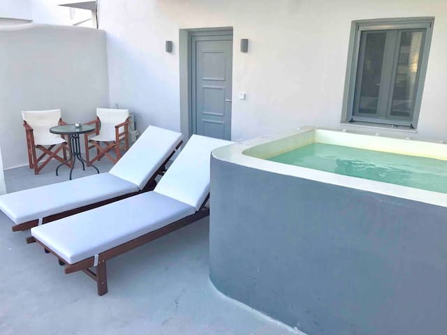 Private jacuzzi , sun beds in the private balcony yard