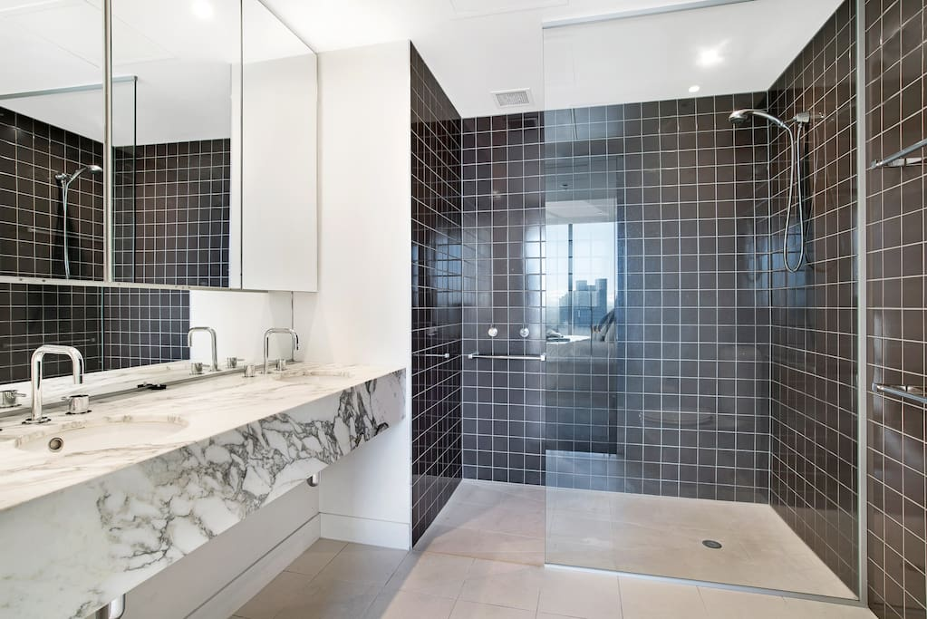 The large, private ensuite Bathroom is soaked in natural light, and features the highest quality finishes.