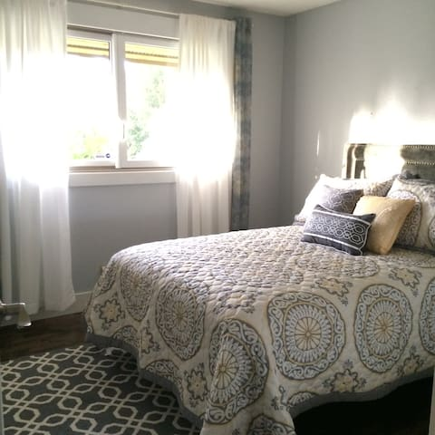 One full size bed in grey/yellow/white