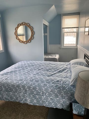 large bedroom with new queen bed