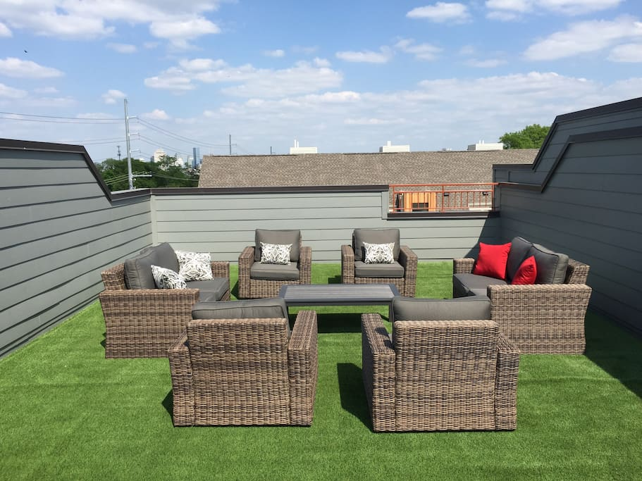 Our spacious rooftop deck offers plenty of space for guests to enjoy the Nashville Skyline