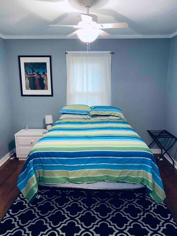 Bedroom w/ full sized mattress, dresser, luggage rack, access to the full bath, closet, 2 drawer dresser, & TV (hooked you antenna for local channels and access to Netflix)