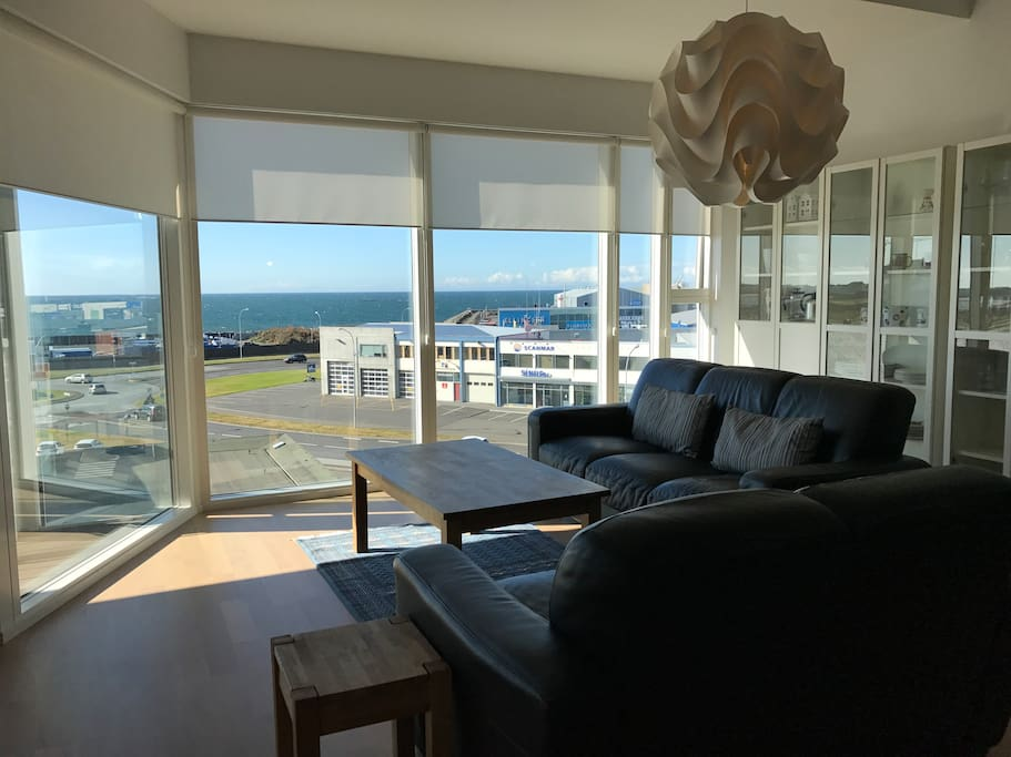 Living room with scenic ocean view during the day