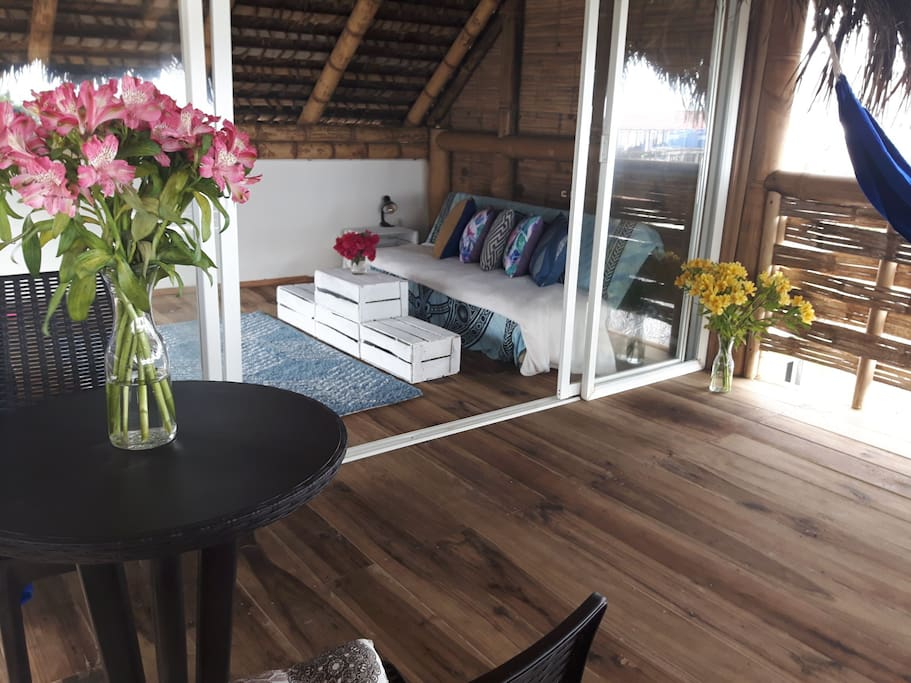 3rd floor is a spare room with fold out bed and balcony. We love using this space to do yoga and see the waves and chill in the 2 hammocks.