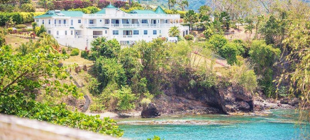 The property is 8000 square feet of space, offering Imposing vistas and old world charm, two ways to describe this wonderful property Secret Cove Villa. The stairs leading to the Cove where one can snorkel and diving.