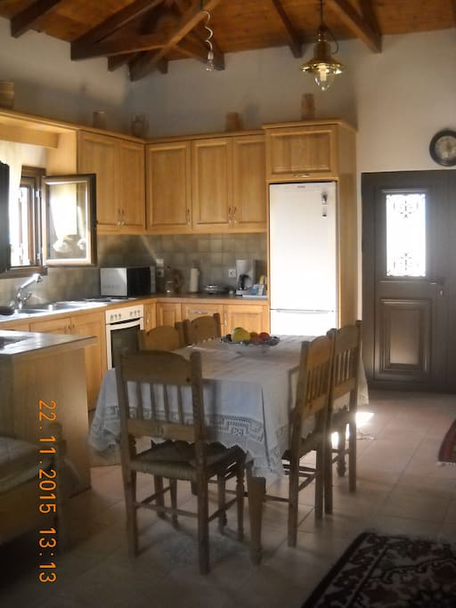 Kitchen's equipment includes fridge, oven, microwave, and dishwasher. There are espresso and American coffee machines.